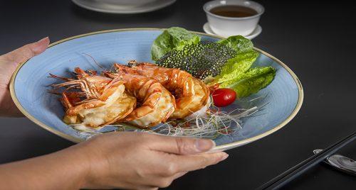 Wah Lok Dish of the Month Pan Fired King Tiger Prawns - TRAVELINDEX